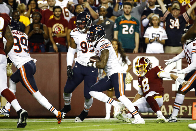 Chicago Bears strong safety Ha Ha Clinton-Dix (21) runs with his interception on the way to the end zone past Washington Redskins quarterback Case Keenum (8) during the first half of an NFL football game Monday, Sept. 23, 2019, in Landover, Md. (AP Photo/Patrick Semansky)