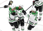 Dallas Stars' Jamie Oleksiak (2) celebrates his goal against the Tampa Bay Lightning with teammates Alexander Radulov (47) and Miro Heiskanen (4) during second-period NHL Stanley Cup finals hockey action in Edmonton, Alberta, Saturday, Sept. 19, 2020. (Jason Franson/The Canadian Press via AP)
