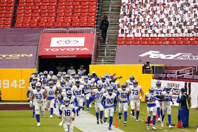 The Los Angeles Rams take the field before an NFL football game against the Washington Football Team Sunday, Oct. 11, 2020, in Landover, Md. (AP Photo/Susan Walsh)