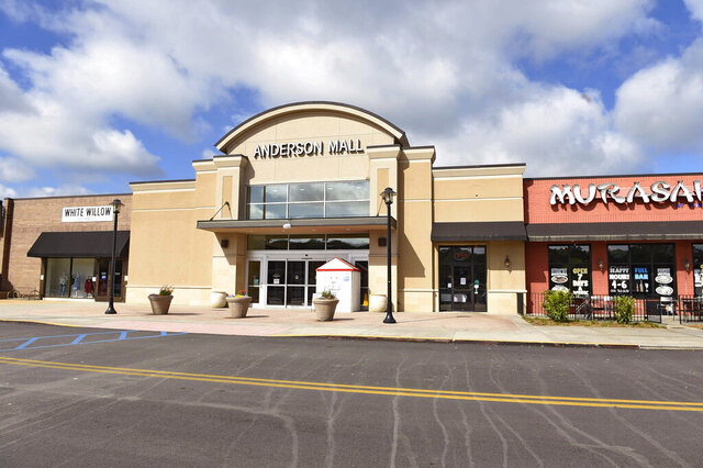 This Friday April 24, 2020 photo shows The Anderson Mall during the coronavirus pandemic, in Anderson, S.C. The mall opened to limited business after Gov. Henry McMaster eased restrictions Friday.  (AP Photo/Richard Shiro)