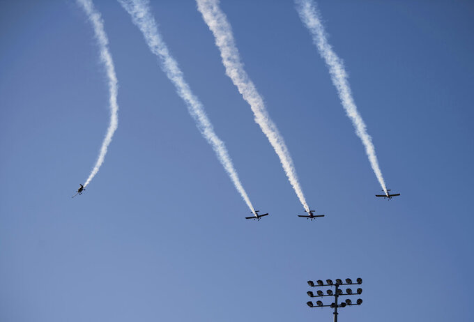 Planes break formation after a fly over before a NASCAR Cup Series auto race at Martinsville Speedway in Martinsville, Va., Sunday, Nov.1, 2020. (AP Photo/Lee Luther Jr.)