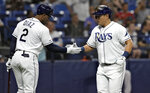 Tampa Bay Rays' Ji-Man Choi, right, celebrates with Yandy Diaz after Choi hit a home run off Baltimore Orioles pitcher David Hess during the third inning of a baseball game Wednesday, April 17, 2019, in St. Petersburg, Fla. (AP Photo/Chris O'Meara)