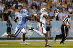 Virginia wide receiver Dontayvion Wicks, right, catches a pass while North Carolina defensive back Ja'Qurious Conley (0) chases during the first half of an NCAA college football game in Chapel Hill, N.C., Saturday, Sept. 18, 2021. (AP Photo/Gerry Broome)