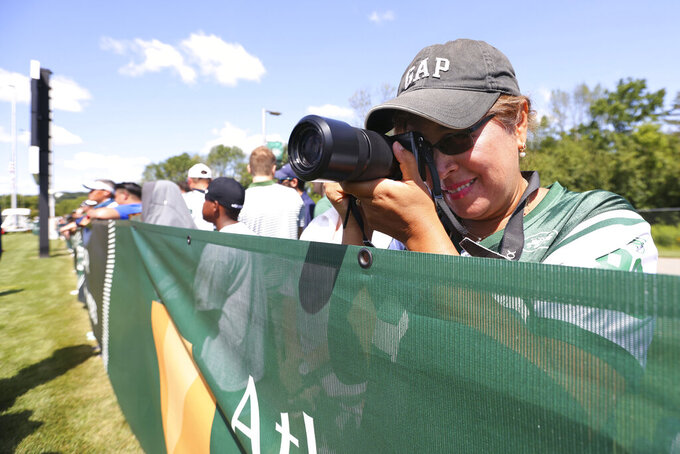 A fan takes a photo during New York Jets practice at the team's NFL football training facility, Saturday, July. 31, 2021, in Florham Park, N.J. (AP Photo/Rich Schultz)