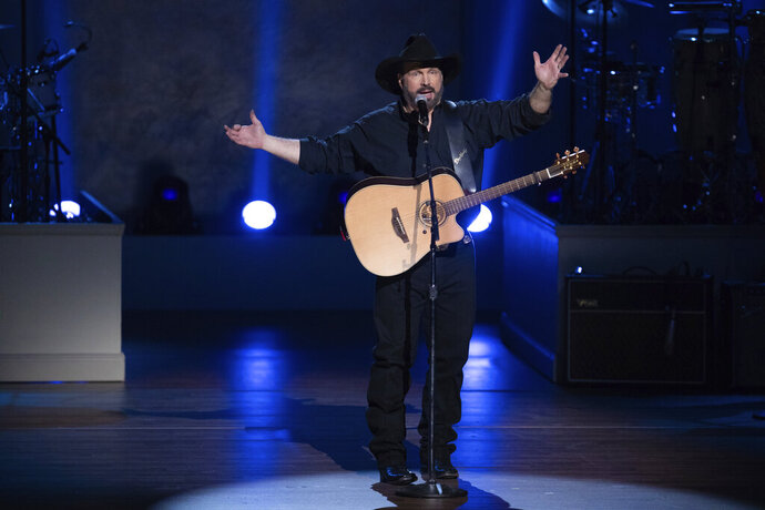 FILE - In this March 4, 2020, file photo, Garth Brooks performs on stage during the 2020 Gershwin Prize Honoree's Tribute Concert at the DAR Constitution Hall in Washington. (Photo by Brent N. Clarke/Invision/AP)