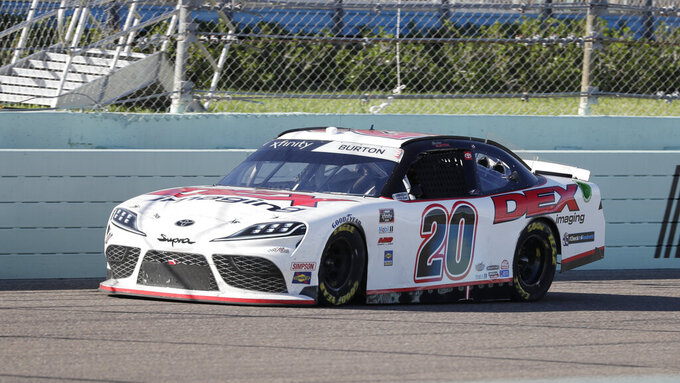 Harrison Burton (20) drives during a NASCAR Xfinity Series auto race Saturday, June 13, 2020, in Homestead, Fla. (AP Photo/Wilfredo Lee)