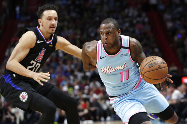 Miami Heat guard Dion Waiters (11) drives to the basket as Los Angeles Clippers guard Landry Shamet (20) defends during the second half of an NBA basketball game, Friday, Jan. 24, 2020, in Miami. (AP Photo/Lynne Sladky)