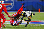 Buffalo Bills wide receiver Andre Roberts (18) is tackled by Pittsburgh Steelers cornerback Justin Layne (31) during the second half of an NFL football game in Orchard Park, N.Y., Sunday, Dec. 13, 2020. (AP Photo/Jeffrey T. Barnes )