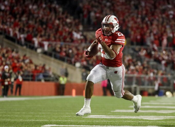 FILE - In this Oct. 6, 2018, file photo, Wisconsin's Jonathan Taylor runs for a touchdown during the second half of an NCAA college football game against Nebraska, in Madison, Wis. Taylor was named to The Associated Press Midseason All-America team, Tuesday, Oct. 16, 2018. (AP Photo/Morry Gash, File)