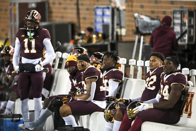 Minnesota players are dejected after a turnover and touchdown by Michigan early in the first half of an NCAA college football game Saturday, Oct. 24, 2020, in Minneapolis, Minn.  (Aaron Lavinsky/Star Tribune via AP)
