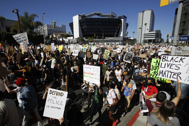 Demonstrators March Sunday June, 7, 2020 in the Hollywood area of Los Angeles, during a protest over the death of George Floyd who died May 25 after he was restrained by Minneapolis police. (AP Photo/Marcio Jose Sanchez)