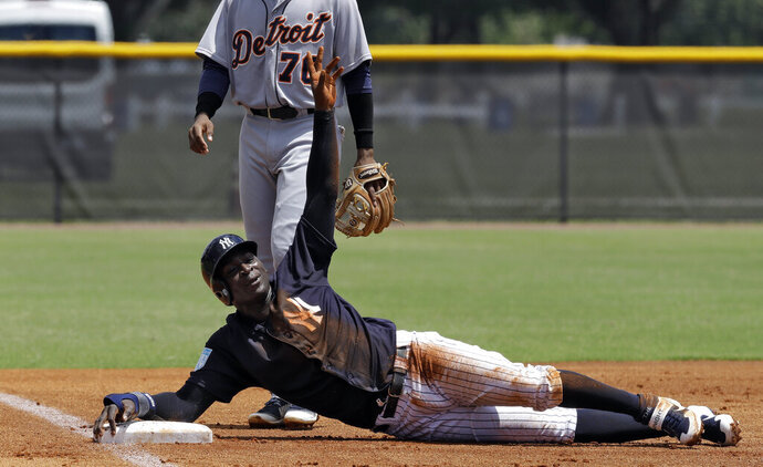 New York Yankees' Didi Gregorius calls for time out after sliding into third base during the first inning of a Gulf Coast League baseball game Monday, May 20, 2019, in Tampa, Fla. Gregorius is playing for the first time since having Tommy John surgery. (AP Photo/Chris O'Meara)