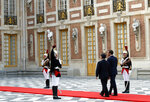 Japan's Crown Prince Naruhito, center right, and French President Emmanuel Macron enter the Chateau de Versailles, west of Paris, for a meeting, Wednesday, Sept. 12, 2018. Japan's Crown Prince Naruhito is for a nine-day goodwill visit in France. (AP Photo/Christophe Ena)