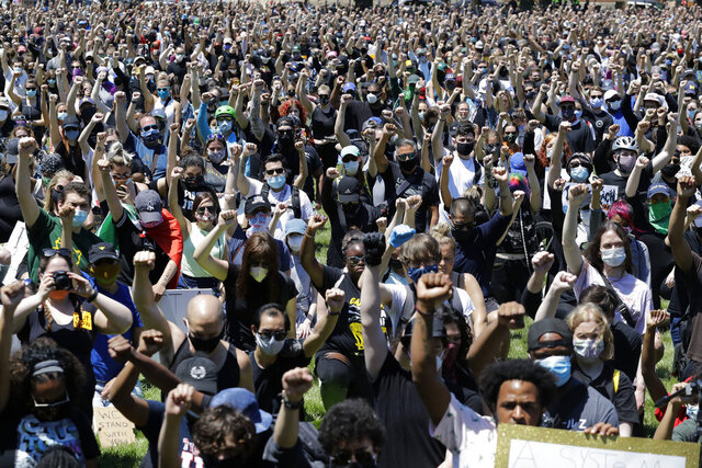 Thousands of people gather for the Chicago March for Justice in honor of George Floyd at Chicago's Union Park Saturday, June 6, 2020, in Chicago. Demonstrators who gathered at Union Park marched through the city's West Side on Saturday afternoon, as the city prepared for another weekend of rallies. (AP Photo/Nam Y. Huh)