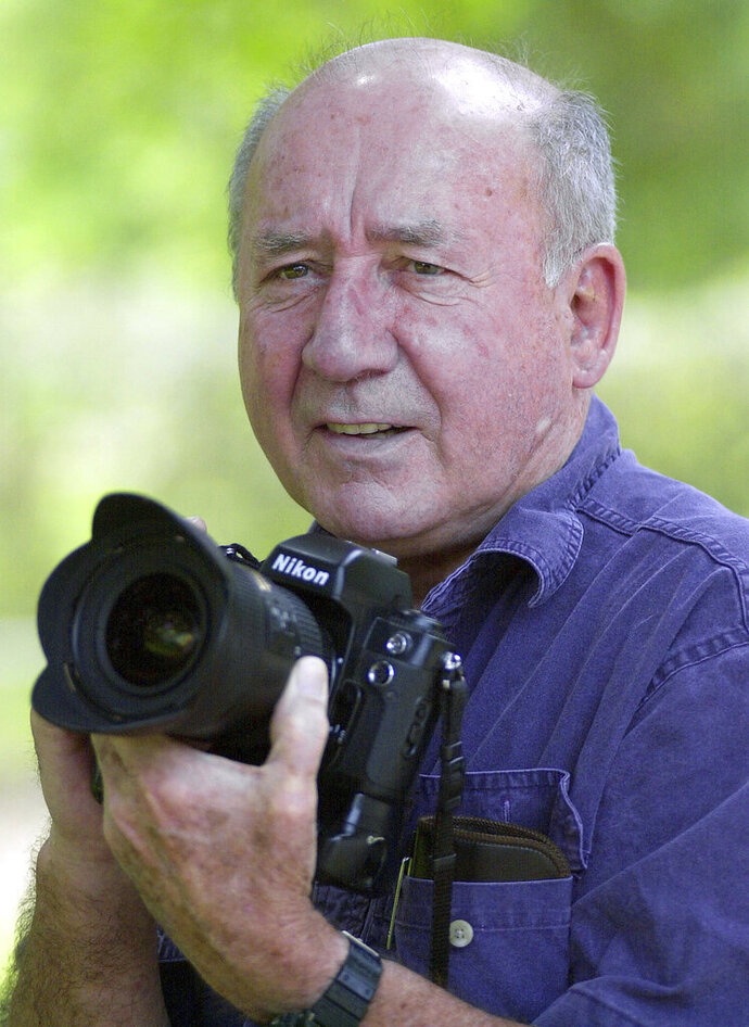In this April 18, 2003 photo, Peter Cosgrove poses for a portrait on April 18, 2003 in Archer, Fla. Cosgrove, an Associated Press photographer in Florida who covered more than 100 space shuttle launches, the Elian Gonzalez saga, countless sporting events and the presidential recount, has died. He was 84. (Phil Sandlin via AP)