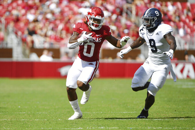 Arkansas running back AJ Green (0) tries to get past Georgia Southern defender Jjay Mcafee (9) as he runs for a big gain during the first half of an NCAA college football game Saturday, Sept. 18, 2021, in Fayetteville, Ark. (AP Photo/Michael Woods)