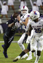 TCU defensive end Dylan Horton (98) grabs Louisiana Tech quarterback Luke Anthony (9) in the fourth quarter during an NCAA college football game, Saturday, Dec. 12, 2020. Anthony sustained a leg injury on the play. (AP Photo/ Richard W. Rodriguez)