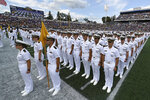 The Brigade of Midshipmen stand at attention during the National Anthem before an NCAA college football game between Navy and Air Force, Saturday, Sept. 11, 2021, in Annapolis, Md. (AP Photo/Terrance Williams)