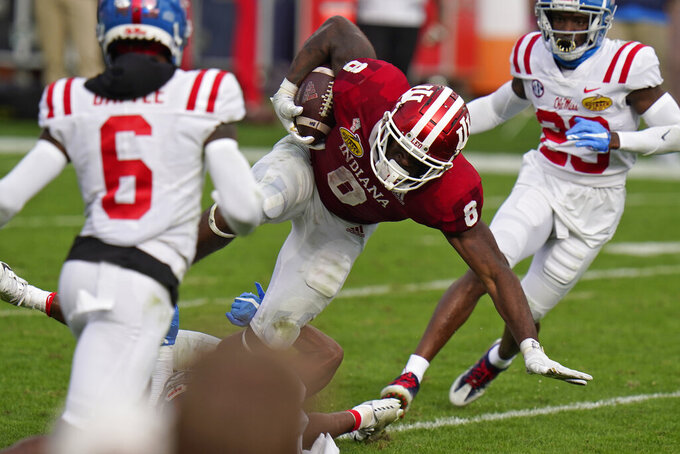 Indiana running back Stevie Scott III (8) picks up yardage against Mississippi during the second half of the Outback Bowl NCAA college football game Saturday, Jan. 2, 2021, in Tampa, Fla. (AP Photo/Chris O'Meara)