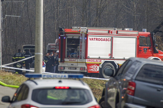 Emergency services at the scene after a fire at a nursing home, in Andrasevac, northern Croatia, Saturday, Jan. 11, 2020.  A fire engulfed part of a nursing home in northern Croatia early Saturday, killing at least six people, authorities said. (AP Photo/Nikola Solic)