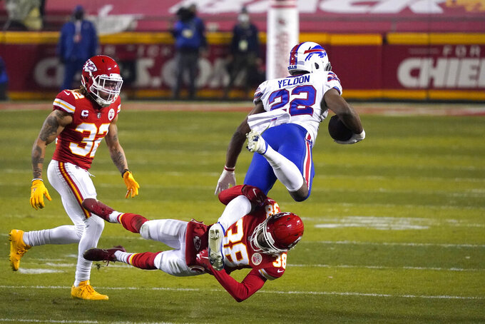 Buffalo Bills running back T.J. Yeldon (22) is tackled by Kansas City Chiefs safety L'Jarius Sneed (38) and safety Tyrann Mathieu (32) during the second half of the AFC championship NFL football game, Sunday, Jan. 24, 2021, in Kansas City, Mo. (AP Photo/Jeff Roberson)