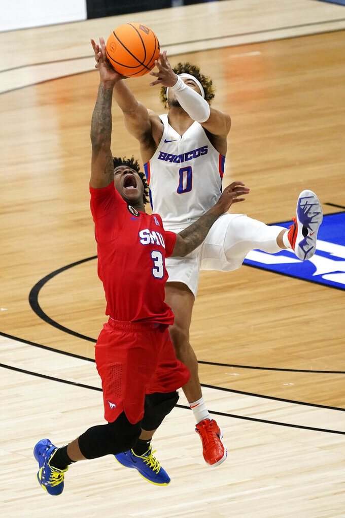 SMU guard Kendric Davis (3) fights for an inbound pass with Boise State guard Marcus Shaver Jr. (0) during the second half of an NCAA college basketball game in the first round of the NIT, Thursday, March 18, 2021, in Frisco, Texas. Boise State won 85-84. (AP Photo/Tony Gutierrez)