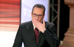 Heinz-Christian Strache, head of Team HC Strache and former leader of the right-wing Freedom Party, FPOE, gestures at the start of a TV debate for local elections in Vienna, Austria, Sunday, Oct. 11, 2020. (AP Photo/Ronald Zak)