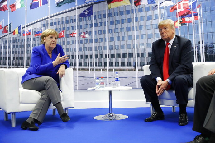 President Donald Trump meets with German Chancellor Angela Merkel during their bilateral meeting at the NATO Summit in Brussels, Belgium, Wednesday, July, 11, 2018. (AP Photo/Pablo Martinez Monsivais)