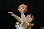 Washington State forward Andrej Jakimovski grabs a rebound during the second half of an NCAA college basketball game against Washington in Pullman, Wash., Monday, Feb. 15, 2021.  (AP Photo/Young Kwak)