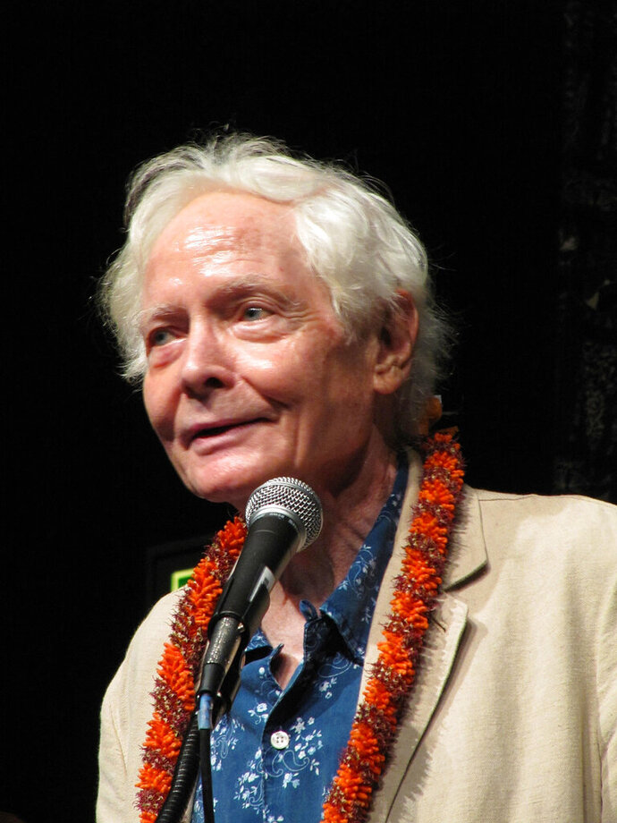 FILE - In this Aug. 2, 2011 file photo, poet W.S. Merwin speaks to the Hawaii Conservation Conference in Honolulu. Merwin, a prolific and versatile master of modern poetry who evolved through a wide range of styles as he celebrated nature, condemned war and industrialism and reached for the elusive past, died on Friday, March 15, 2019 at his home in Hawaii. A Pulitzer Prize winner and former U.S. poet laureate, Merwin completed more than 20 books and ranked high in the pantheon for decades, from early works inspired by myths and legends to late meditations on age and time. (AP Photo/Audrey McAvoy, File)