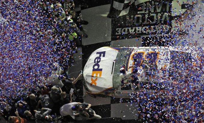 Denny Hamlin is showered with confetti in Victory Lane after winning a NASCAR Daytona 500 auto race Sunday, Feb. 17, 2019, at Daytona International Speedway in Daytona Beach, Fla. (AP Photo/Chris O'Meara)