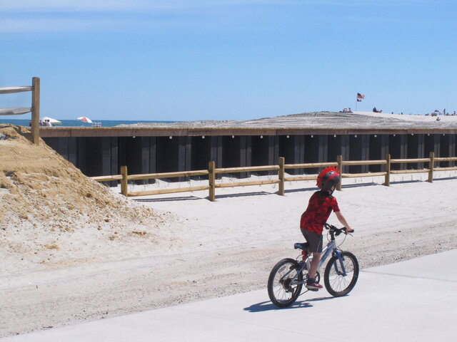 This Monday,  June 8, 2020 photo shows a sea wall in North Wildwood, N.J. On June 6, 2020, the New Jersey Department of Environmental Protection said North Wildwood had demolished dunes and wetlands, built the sea wall and added buildings to a pier without required permits or review by the agency, which may make the city tear the work it did, and restore the area to its natural condition. (AP Photo/Wayne Parry)