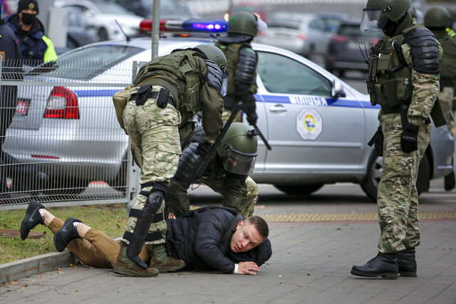 Police detain a demonstrator during an opposition rally to protest the official presidential election results in Minsk, Belarus, Sunday, Nov. 1, 2020. Some thousands of protesters swarmed the streets of the Belarus' capital on Sunday, demanding the resignation of the country's longtime authoritarian leader, and were met with police firing warning shots into the air and using stun grenades to break up the crowds.  (AP Photo)