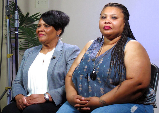 FILE - In this June 7, 2018, file photo, Alice Marie Johnson, left, and her daughter Katina Marie Scales wait to start a TV interview in Memphis, Tenn. Crystal Munoz, a 40-year-old Texas woman, was among nearly a dozen people granted clemency Tuesday, Feb. 18, 2020, by President Donald Trump after her case was championed by Johnson, who herself got clemency at the urging of reality TV star Kim Kardashian West. Johnson, spent years with Munoz at a federal prison in Fort Worth, Texas. (AP Photo/Adrian Sainz, File)