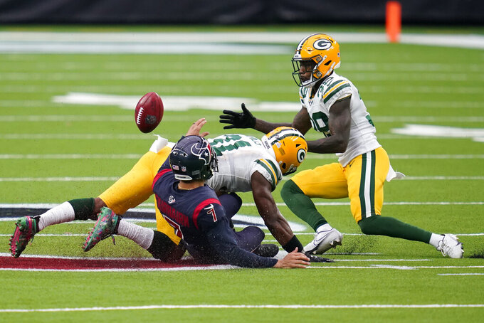 Green Bay Packers' Chandon Sullivan, right, is unable to recover an on-side kick by Houston Texans place kicker Ka'imi Fairbairn (7) during the second half of an NFL football game Sunday, Oct. 25, 2020, in Houston. The Texans recovered the kick. (AP Photo/Sam Craft)