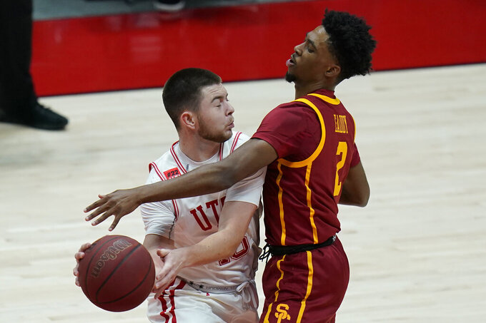 Southern California guard Tahj Eaddy (2) defends against Utah guard Rylan Jones during the first half of an NCAA college basketball game Saturday, Feb. 27, 2021, in Salt Lake City. (AP Photo/Rick Bowmer)