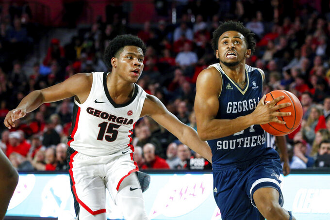 Georgia Southern's David-Lee Jones Jr. (24) drives to the basket as Georgia's Sahvir Wheeler defends during an NCAA college basketball game Monday, Dec. 23, 2019, in Athens, Ga. (Casey Sykes/Athens Banner-Herald via AP)