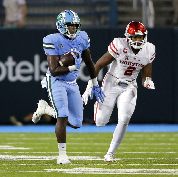 Tulane tight end Tyrick James (80) outruns Houston linebacker Deontay Anderson (2) for a long gain in the first half during an NCAA college football game in New Orleans, Thursday, Oct. 7, 2021. (A.J. Sisco/The Advocate via AP)