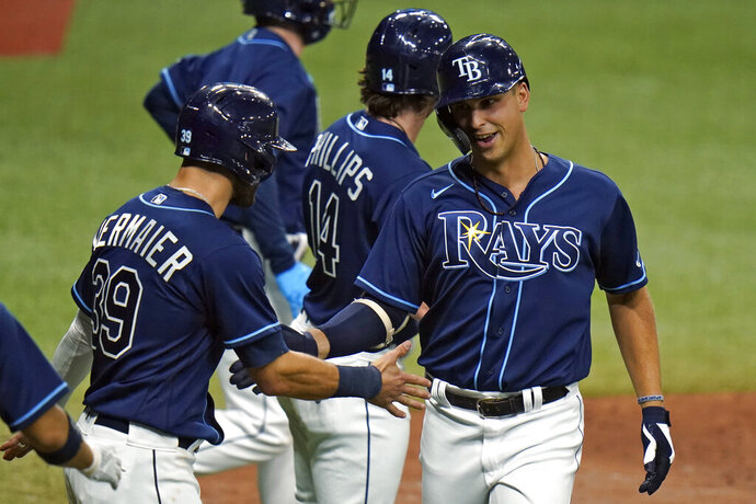 Tampa Bay Rays' Nate Lowe celebrates his three-run home run off Boston Red Sox relief pitcher Robinson Leyer with Kevin Kiermaier (39) during the seventh inning of a baseball game Friday, Sept. 11, 2020, in St. Petersburg, Fla. (AP Photo/Chris O'Meara)