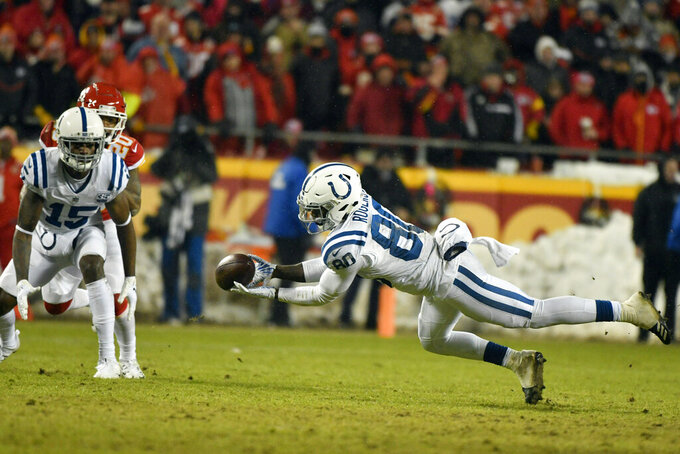 Indianapolis Colts wide receiver Dontrelle Inman (15) and Kansas City Chiefs cornerback Steven Nelson (20) watch as Colts wide receiver Chester Rogers (80) can't hold on to a pass during the second half of an NFL divisional football playoff game in Kansas City, Mo., Saturday, Jan. 12, 2019. (AP Photo/Ed Zurga)