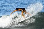 France's Johanne Defay rides a wave during a training session at the 2020 Summer Olympics, Friday, July 23, 2021, at Tsurigasaki beach in Ichinomiya, Japan. (AP Photo/Francisco Seco)