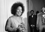 FILE - In this March 4, 1974 file photo, Roberta Flack holds the Grammy award for her record,
