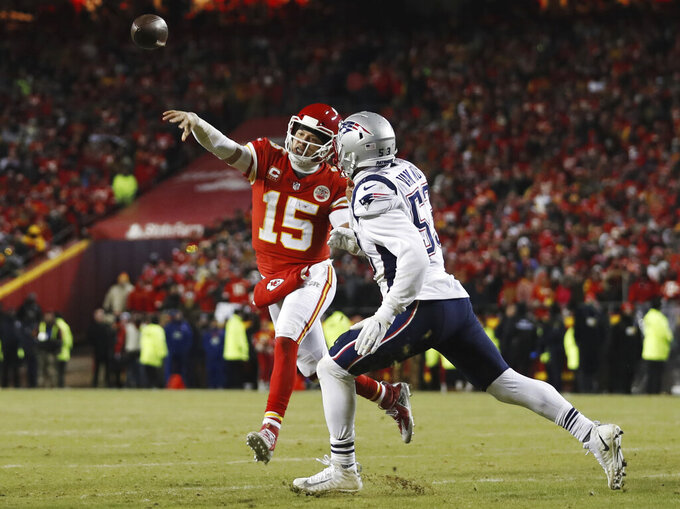 Kansas City Chiefs quarterback Patrick Mahomes (15) throws a touchdown pass to running back Damien Williams against New England Patriots middle linebacker Kyle Van Noy (53) during the second half of the AFC Championship NFL football game, Sunday, Jan. 20, 2019, in Kansas City, Mo. (AP Photo/Jeff Roberson)