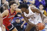 Arizona center Chase Jeter (4) pressures Washington forward Isaiah Stewart (33) during the first half of an NCAA college basketball game Thursday, Jan. 30, 2020, in Seattle. (AP Photo/Ted S. Warren)