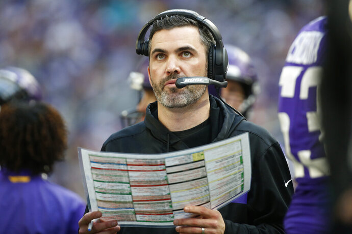 FILE - In this Dec. 16, 2018, file photo, Minnesota Vikings interim offensive coordinator Kevin Stefanski watches from the sideline during the first half of an NFL football game against the Miami Dolphins in Minneapolis. The Cleveland Browns are hiring Stefanski as their new coach, a person familiar with the decision told the Associated Press. Stefanski agreed to accept the position Sunday, Jan. 12, 2020, a day after Minnesota was beaten by San Francisco in the NFC playoffs, according to the person who spoke to the AP on condition of anonymity because the team has not announced the decision.   (AP Photo/Bruce Kluckhohn, File)