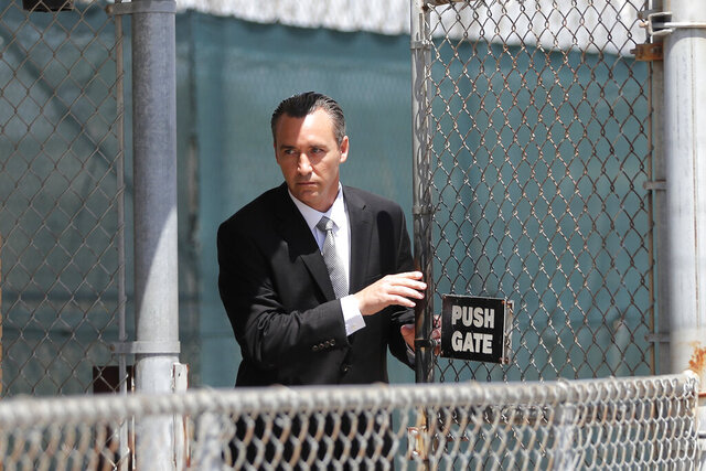 FILE - In this April 21, 2020, file photo, Tony Spell, pastor of the Life Tabernacle Church, leaves East Baton Rouge Parish jail after posting bond in Baton Rouge, La. Louisiana authorities arrested the pastor on an assault charge after he admitted that he drove his church bus toward a man who has been protesting his decision to hold mass gatherings in defiance of public health orders during the coronavirus pandemic. (AP Photo/Gerald Herbert, File)