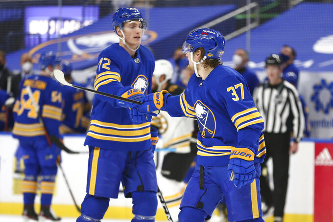 Buffalo Sabres forward Casey Mittelstadt (37) celebrates his goal against the Boston Bruins with forward Tage Thompson (72) during the second period of an NHL hockey game Friday, April 23, 2021, in Buffalo, N.Y. (AP Photo/Jeffrey T. Barnes)