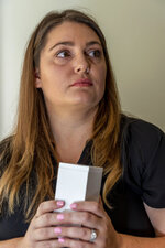 ADVANCE FOR RELEASE SUNDAY, SEPT. 8, 2019, AND THEREAFTER - In this Aug. 29, 2019, photo, Hevan Lunsford poses with the ashes of her son, Sebastian Mark Lunsford, in Prattville, Ala. Lunsford found out when she was five months pregnant that the baby was severely underdeveloped and had only half of a heart. Lunsford said she felt the only way to guarantee her son would not suffer would be to end the pregnancy and was told she would need to travel to Georgia for the procedure. Lunsford is one of thousands of women across the U.S. in recent years who have crossed state lines for an abortion. (AP Photo/Vasha Hunt)