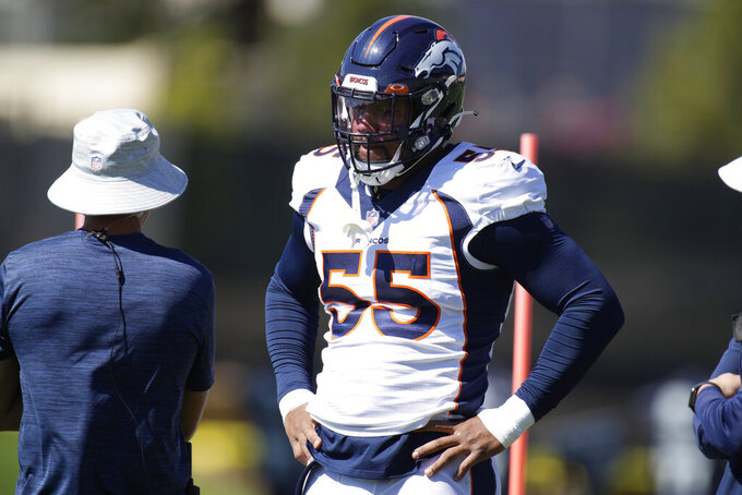 Denver Broncos outside linebacker Bradley Chubb, right, confers with head trainer Vince Garcia as Chubb takes part in drills during an NFL football practice Thursday, Sept. 16, 2021, at the team's headquarters in Englewood, Colo. (AP Photo/David Zalubowski)
