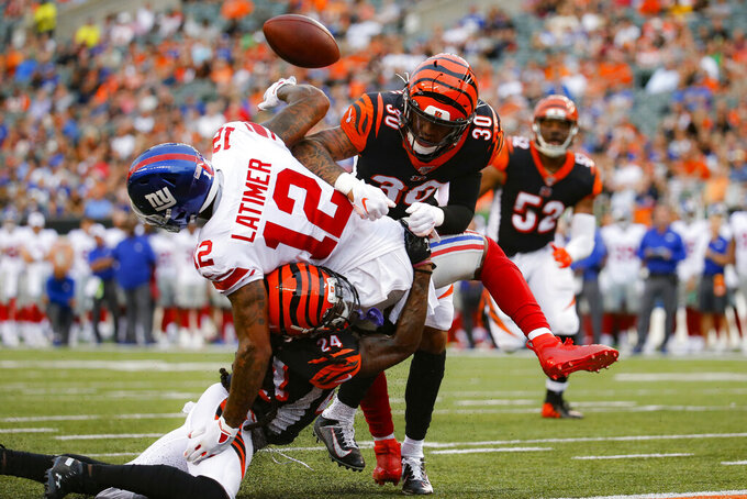 Cincinnati Bengals free safety Jessie Bates (30) and cornerback B.W. Webb (24) break up a pass to New York Giants wide receiver Cody Latimer (12) during the first half of an NFL preseason football game Thursday, Aug. 22, 2019, in Cincinnati. (AP Photo/Frank Victores)